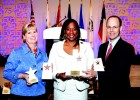 Dallas Bar Association Executive Director Cathy Maher (left), and DBA President Scott McElhaney, of Jackson Walker LLP, (right), accept awards from State Bar of Texas President Lisa Tatum (center)