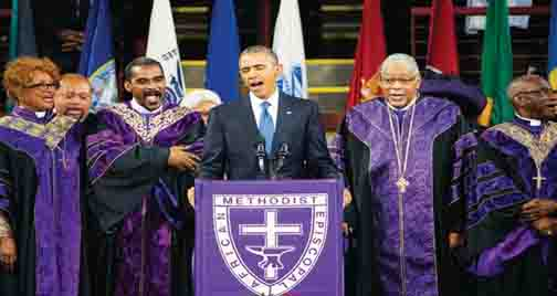 "President Barack Obama sings ""Amazing Grace"" during services honoring the life of Rev. Clementa Pinckney, Friday, June 26, 2015, at the College of Charleston TD Arena in Charleston, S.C.. Pinckney was one of the nine people killed in the shooting at Emanuel AME Church last week in Charleston. (AP Photo/David Goldman)"