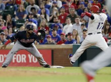 Cleveland Indians first baseman Carlos Santana, left, catches the throw from starting pitcher Carlos Carrasco to force out Texas Rangers Shin‐Soo Choo on his attempted bunt during the fifth inning of a baseball game Tuesday, April 4, 2017, in Arlington, Texas. (AP Photo/Brandon Wade)
